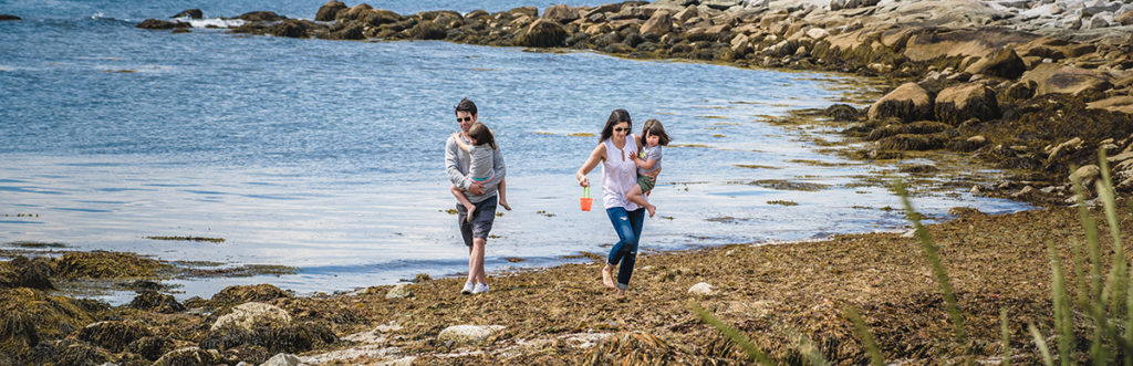 A family visiting our property and taking a stroll by the ocean.