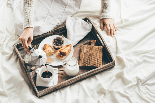 A breakfast spread on a bed